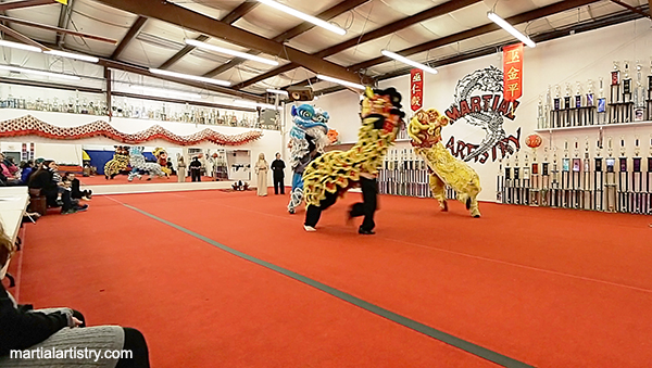 The Albuquerque Martial Artistry Shaolin Kung Fu and Chinese Wushu school guardian lions perform a celebratory dance for our newest wushu black sash, Diana Ma.  Diana was a gold medalist in Tae Kwon Do martial arts, and has been studying with Martial Artistry for 14 years.