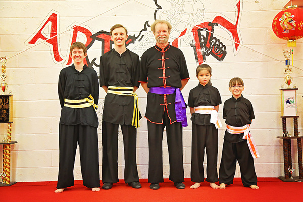 Kung Fu class members earn new sashes and martial arts ranks.