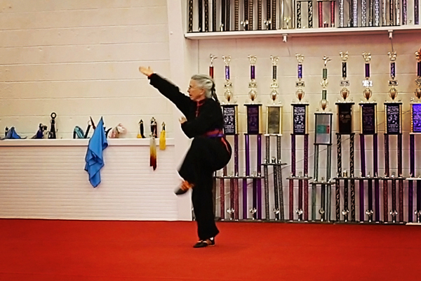 Dorothy Stender achieved a kung fu purple-black sash for her presentation of a long fist form.