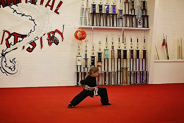 M Saville graduated from the Little Dragons martial arts classes, and will now be in the kids kung fu class.