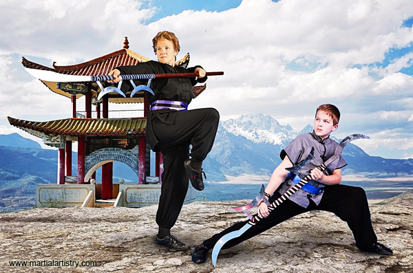 Sherry and Samson Riddle wield kung fu horse chopping sword and heaven and earth, sun and moon sword. Both take kung fu karate classes in Albuquerque.